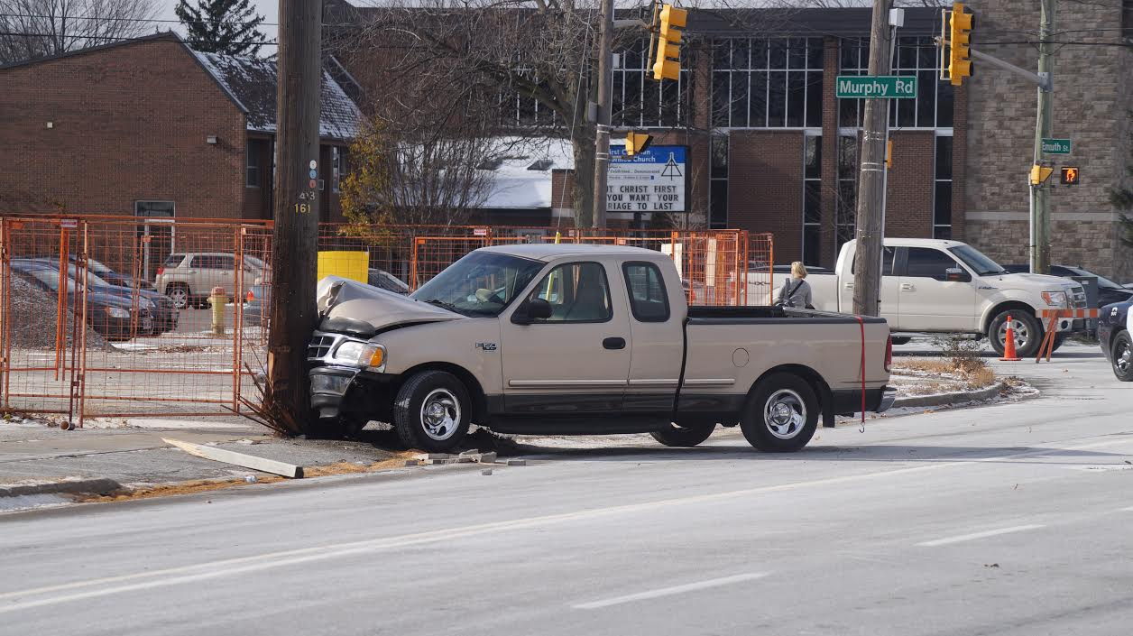 A pickup truck snaps a hydro pole at its base at the intersection of Exmouth St. and Murphy Rd. (BlackburnNews.com photo by Jake Jeffrey)