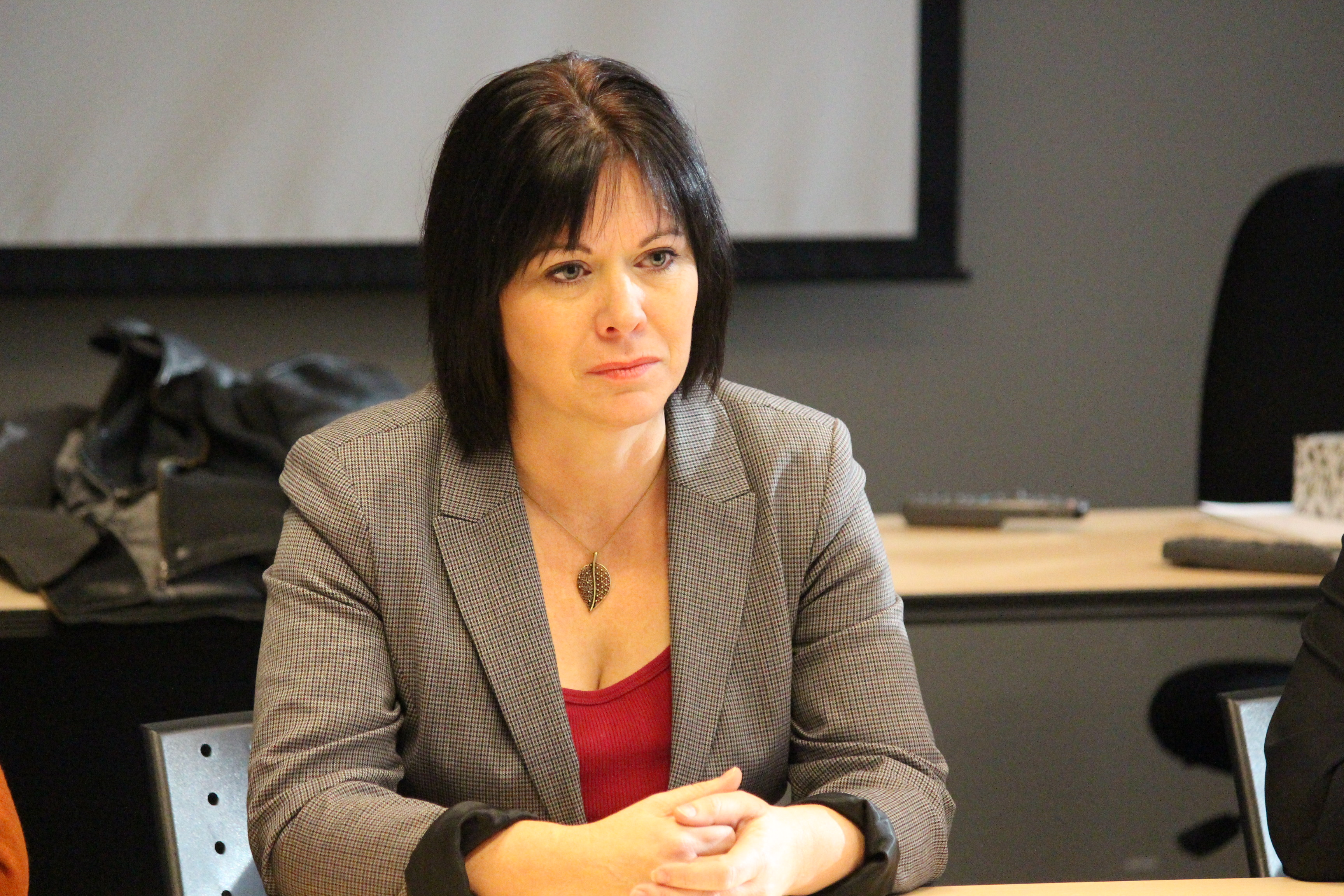 Windsor-West NDP MPP Lisa Gretzky listens to the stories of those affected by cuts at the CCAC. (Photo by Jason Viau)