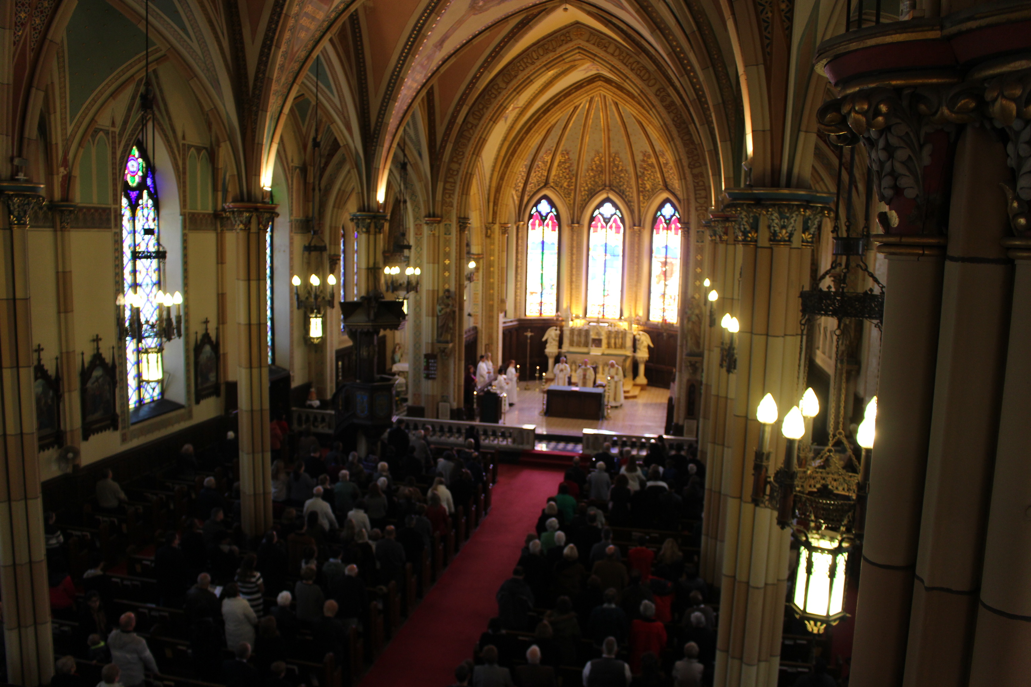 Parishioners gather for what may be the last service at Assumption Church on November 2, 2014. (Photo by Jason Viau)
