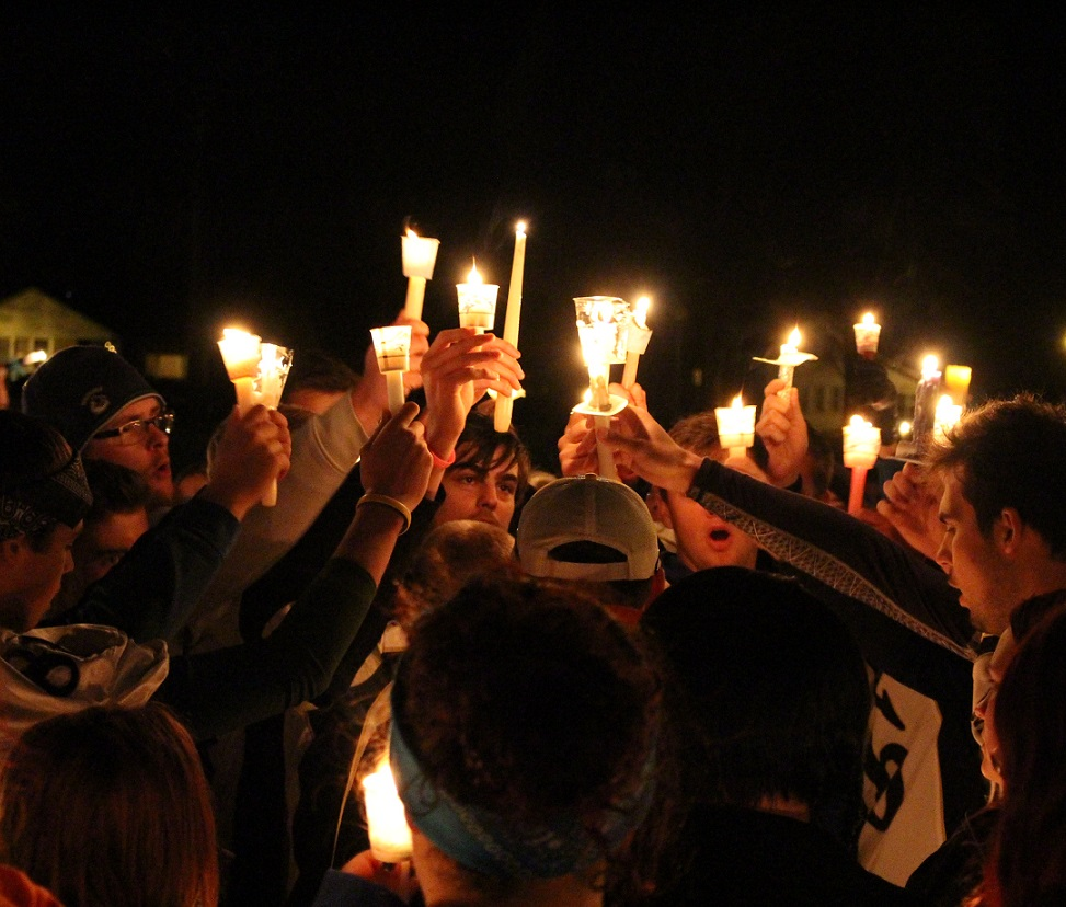 Teammates, friends and family of Michael Matte gather outside of General Amherst High School for a candlelight vigil, November 10, 2014. (photo by Mike Vlasveld)