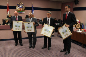 Windsors out-going councillors (from left to right) Fulvio Valentinis, Ron Jones, Alan Halberstadt and Al Magneigh, receiving keys to the city at their final council meeting, November 17, 2014. (photo by Mike Vlasveld)