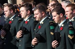 Members of the Canadian military stand in honour of fallen Canadian soldiers at the cenotaph in Windsor, November 11, 2014. (photo by Mike Vlasveld)