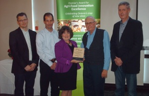 Representatives of Truly Green Farms accept an Agri-Food Innovation award, one of five handed out to Chatham-Kent and Essex farms, November 21, 2014. (Photo by Simon Crouch)