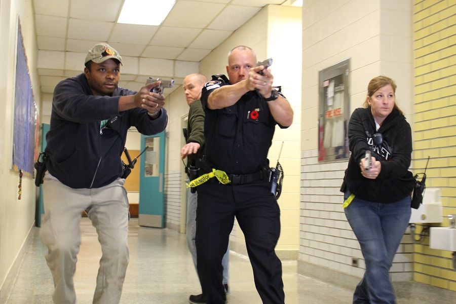 Members of the Windsor Police Service participate in active shooter training at the former Victoria Public School in Tecumseh.