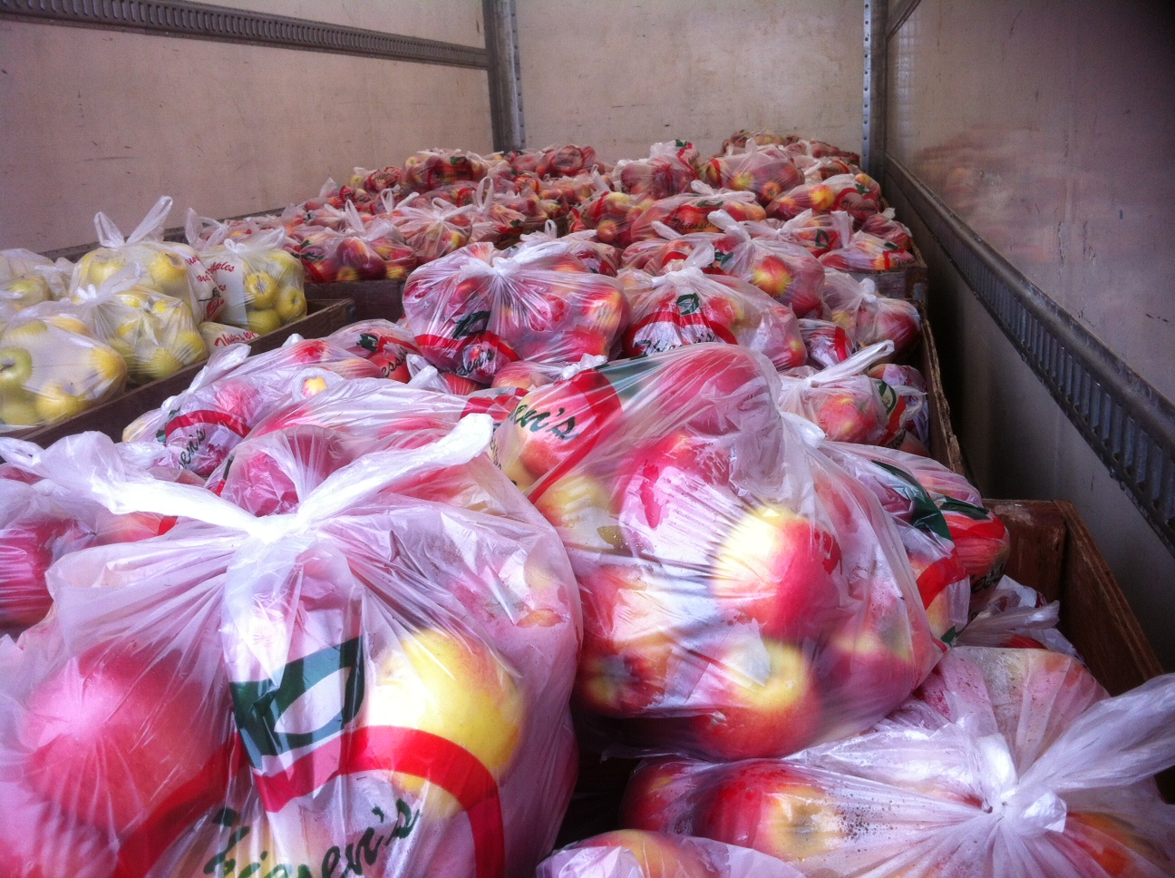 Bags of apples donated by Thiessen's Orchard. (Photo by Kevin Black.)