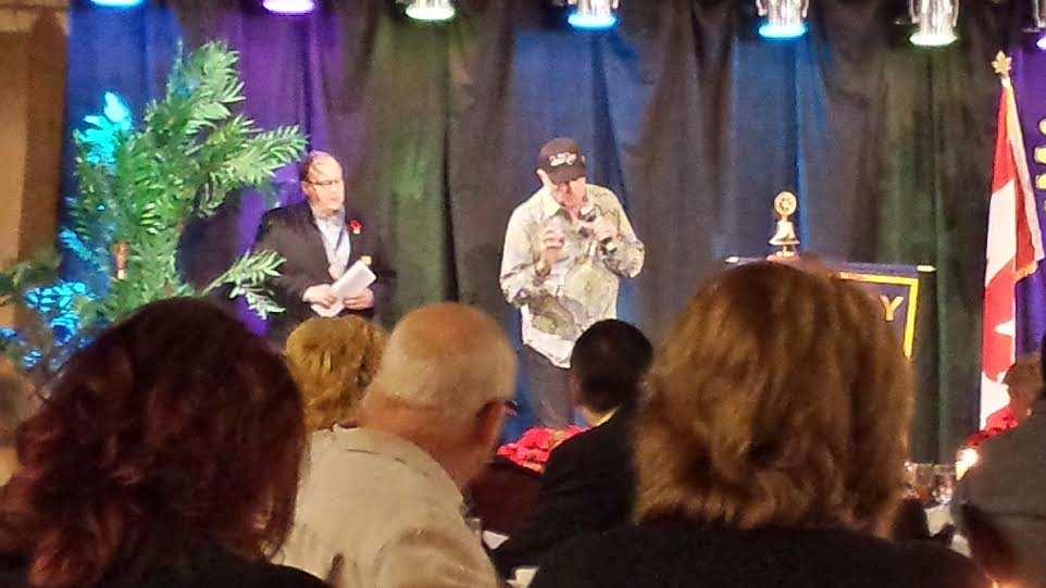 Beach Boys co-founder Mike Love (centre) speaks to a crowd at the Rotary Club's 75th banquet in Chatham. November 9, 2014. (Photo courtesy of Walter Ploegman)