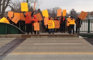Chatham-Kent residents gather on the 3rd St. Bridge in Chatham to protest violence against women. November 25, 2014. (Photo submitted by Jenny Pelisek)