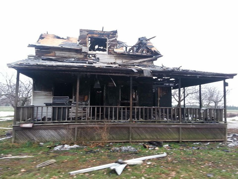 A home on Talbot Trail south of Blenheim was destroyed by fire on November 22, 2014. (Photo by Ashton Patis)