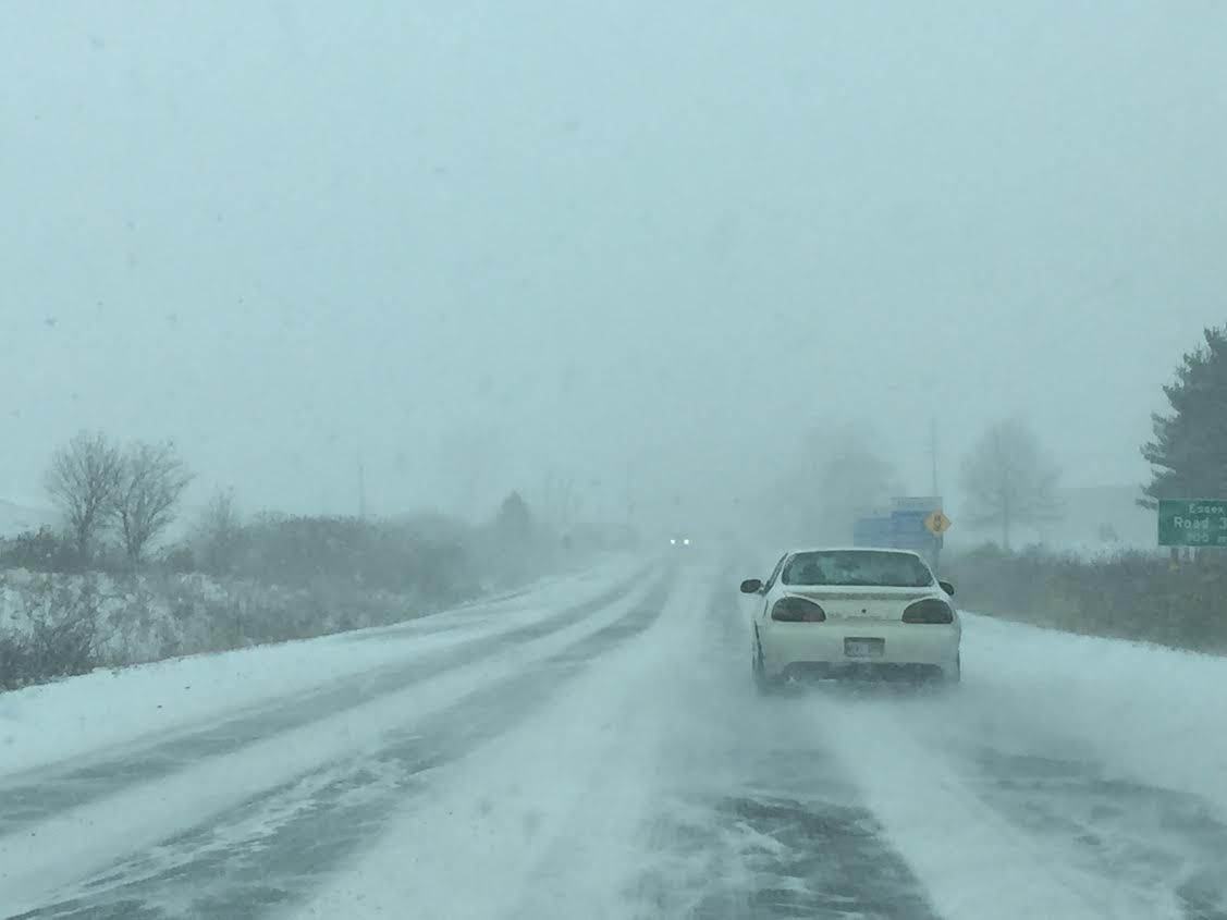 Poor road conditions on Highway 3 between Leamington and Kingsville as snow continues to fall.