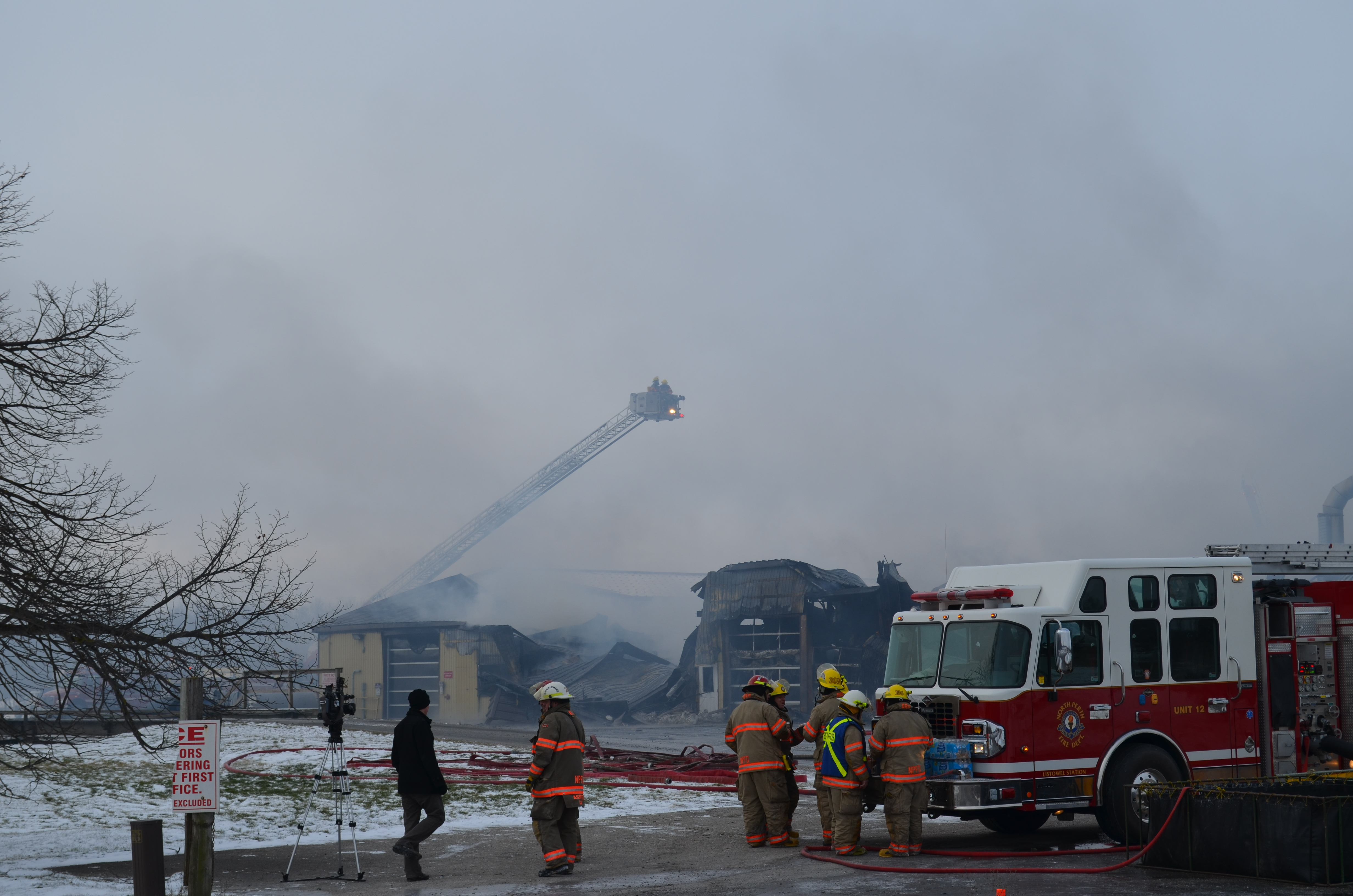 Firefighters use aerial ladder to douse hotspots (blackburnnews.com photo)