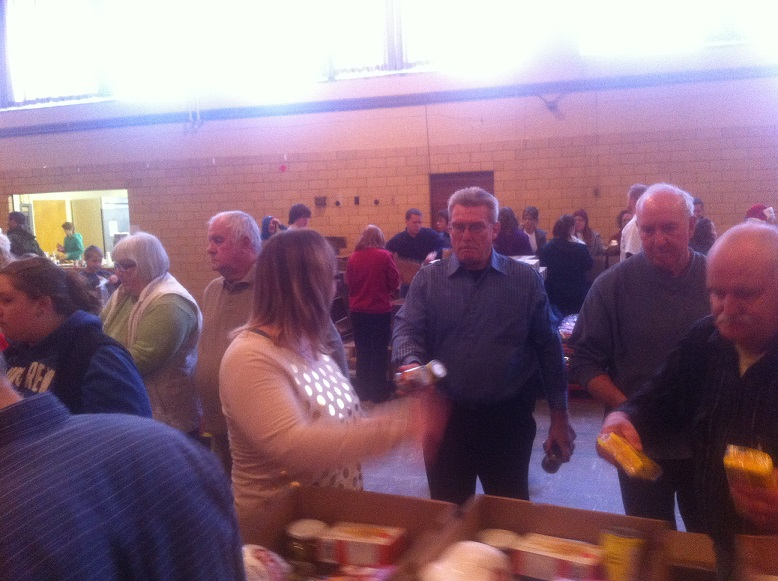Volunteers pack food baskets for Chatham Goodfellows. (Photo by Mike James)