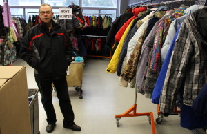 Russ Anderson with Coats For Kids Windsor-Essex talks about this years donations at the Rose City Islamic Centre, December 18, 2014. (photo by Mike Vlasveld)