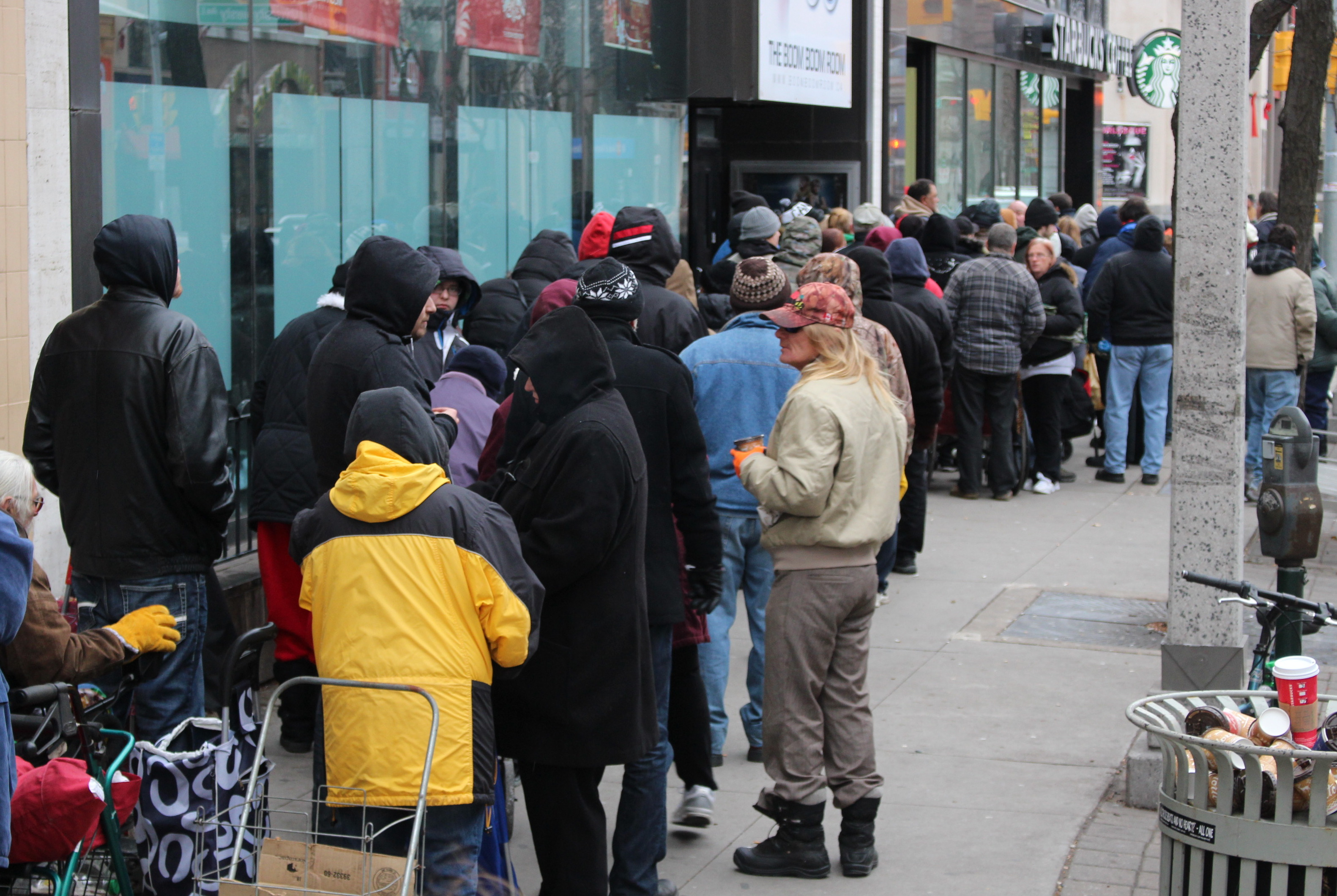 People in need line up along Ouellette Ave. in Windsor in hopes of receiving one of 500 turkeys being given away, December 17, 2014. (photo by Mike Vlasveld)