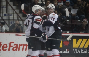 The Windsor Spitfires celebrate after a goal, December 31, 2014. (Photo by Mike Vlasveld)