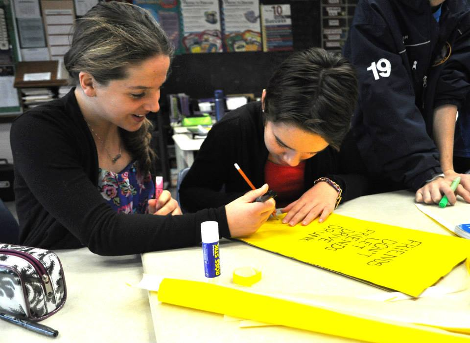 St. Joseph Catholic Elementary School students Selia Dion, left, and Semonde Snauwaert create bags with messages against drunk driving. (Photo courtesy Stephen Fields/WECDSB)