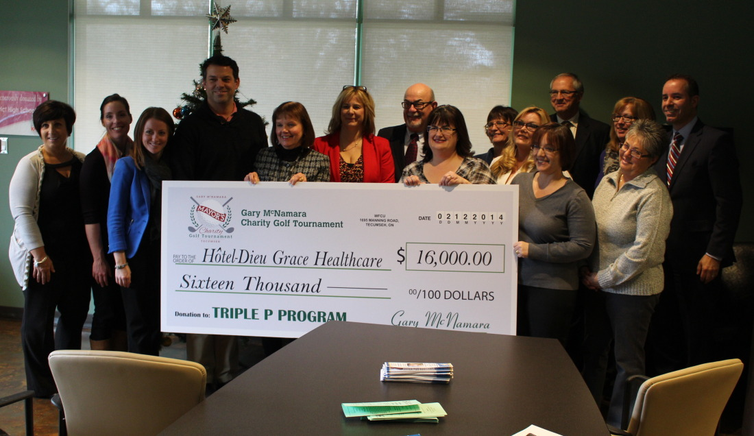 Tecumseh Mayor Gary McNamara presents a cheque for $16,000 to Hotel-Dieu Grace Healthcare, December 2, 2014. (photo by Mike Vlasveld)