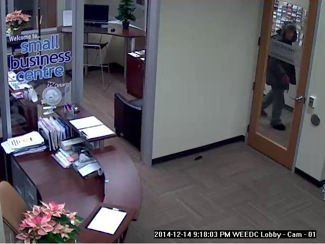Photo of a suspect entering the Windsor Essex Economic Development Corporation. (Photo courtesy of Windsor Police Services.)