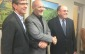 Ridgetown Campus professor Steve Loewen, left, Chatham-Kent-Essex MP Dave Van Kesteren, centre, and Ontario Tomato Research Institute Chair Phil Richards, right, pose for photos at research funding announcement at the Ridgetown Campus on December 19, 2014. (Photo by Ricardo Veneza)