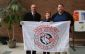 (L to R): Mayor Randy Hope, Crime Stoppers board member Dianne Jacobs, and Crime Stoppers police coordinator David Bakker at the annual flag raising at the Civic Centre. (Photo provided by Crime Stoppers)