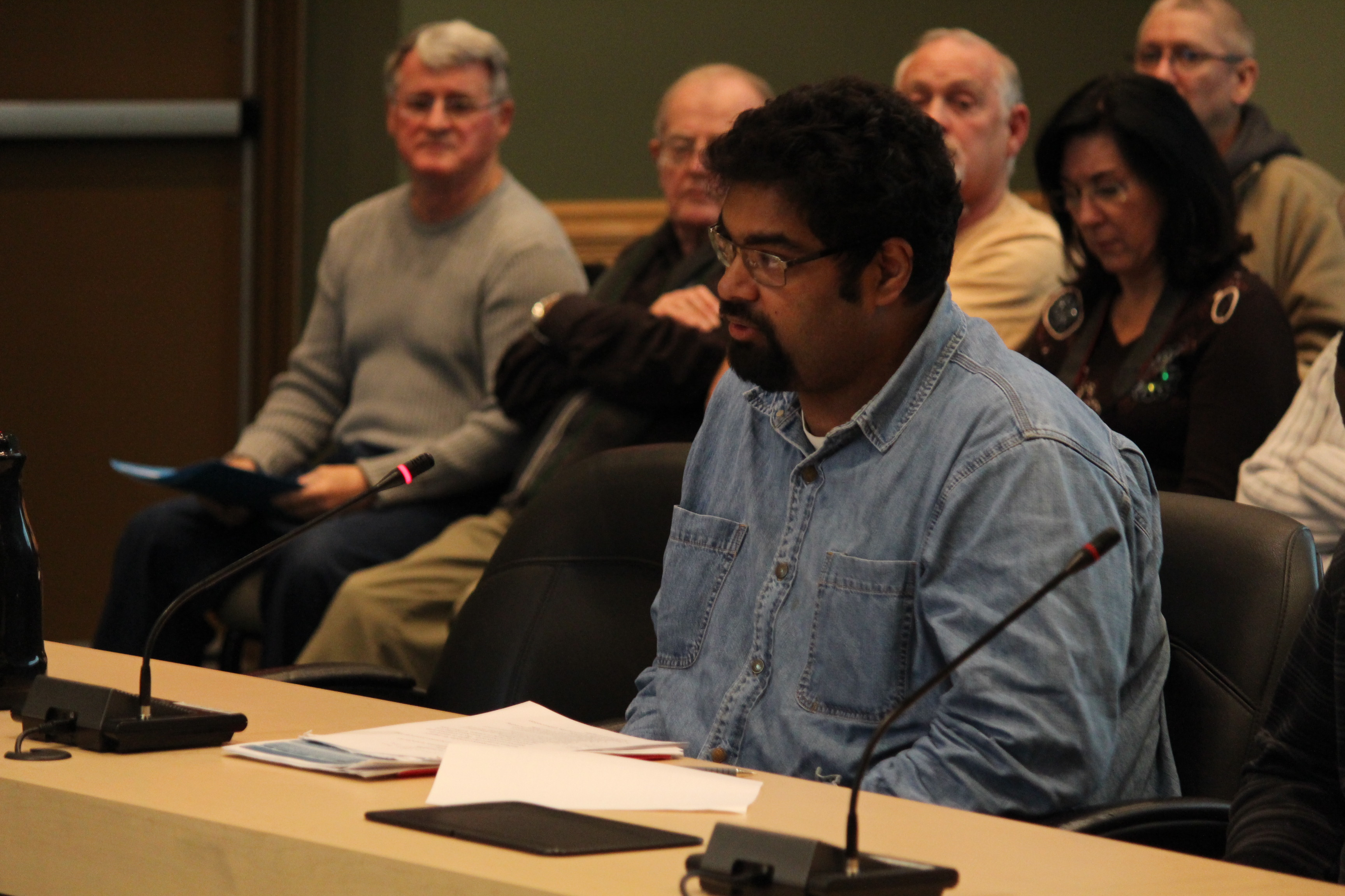 Justice For Migrant Workers Spokesperson Chris Ramsaroop speaking at Tecumseh Town Hall, January 13, 2015. (Photo by Mike Vlasveld)