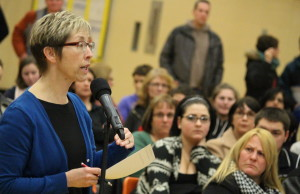 Peggy Thompson speaks at a meeting about the public board reviewing several area schools. (Photo by Jason Viau)