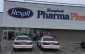 Pharma Plus with London police cars out front