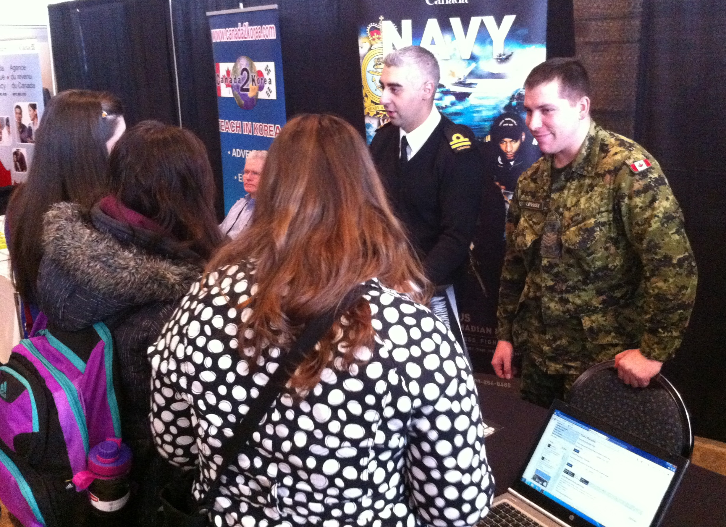 Students visit the Canadian Navy booth at the 16th Annual Job Fair at St. Clair Centre for the Arts in Windsor, January 21, 2015. (Photo by Mike Vlasveld)
