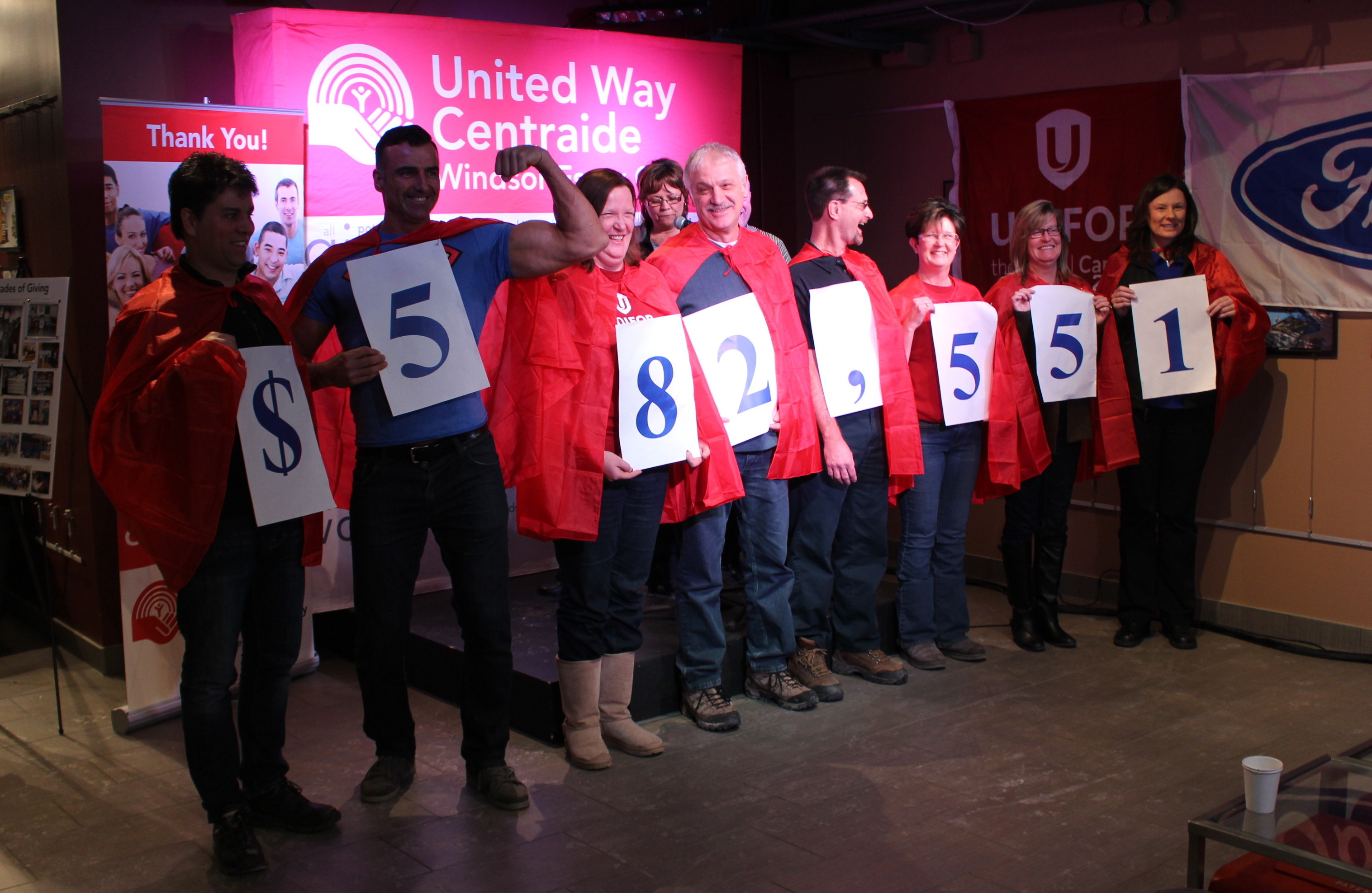 "Unifor Local 200 United Way ""superhero"" canvassers unveil the total donation from 2014, January 9, 2015. (photo by Mike Vlasveld)"