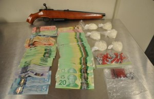 Photo of the drugs, cash and gun seized in a police raid at a Pond Mills Rd. home. Photo courtesy of London Police.