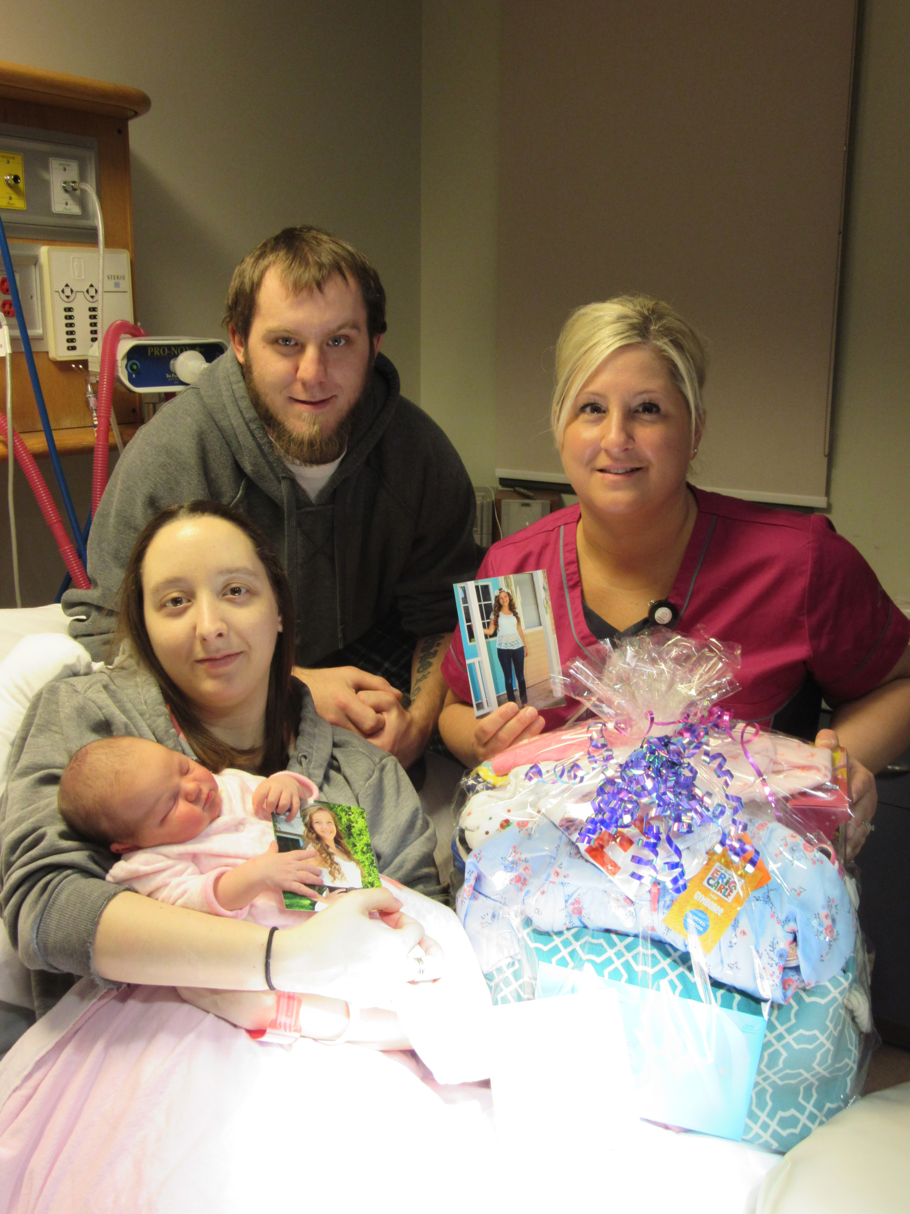 Baby Rylie Osborne with her parents Rachel Rhea and Brad Osborne, and Jolene Hathaway, RPN, Women and Children's Health Department, CKHA. (Photo courtesy Foundation CKHA)
