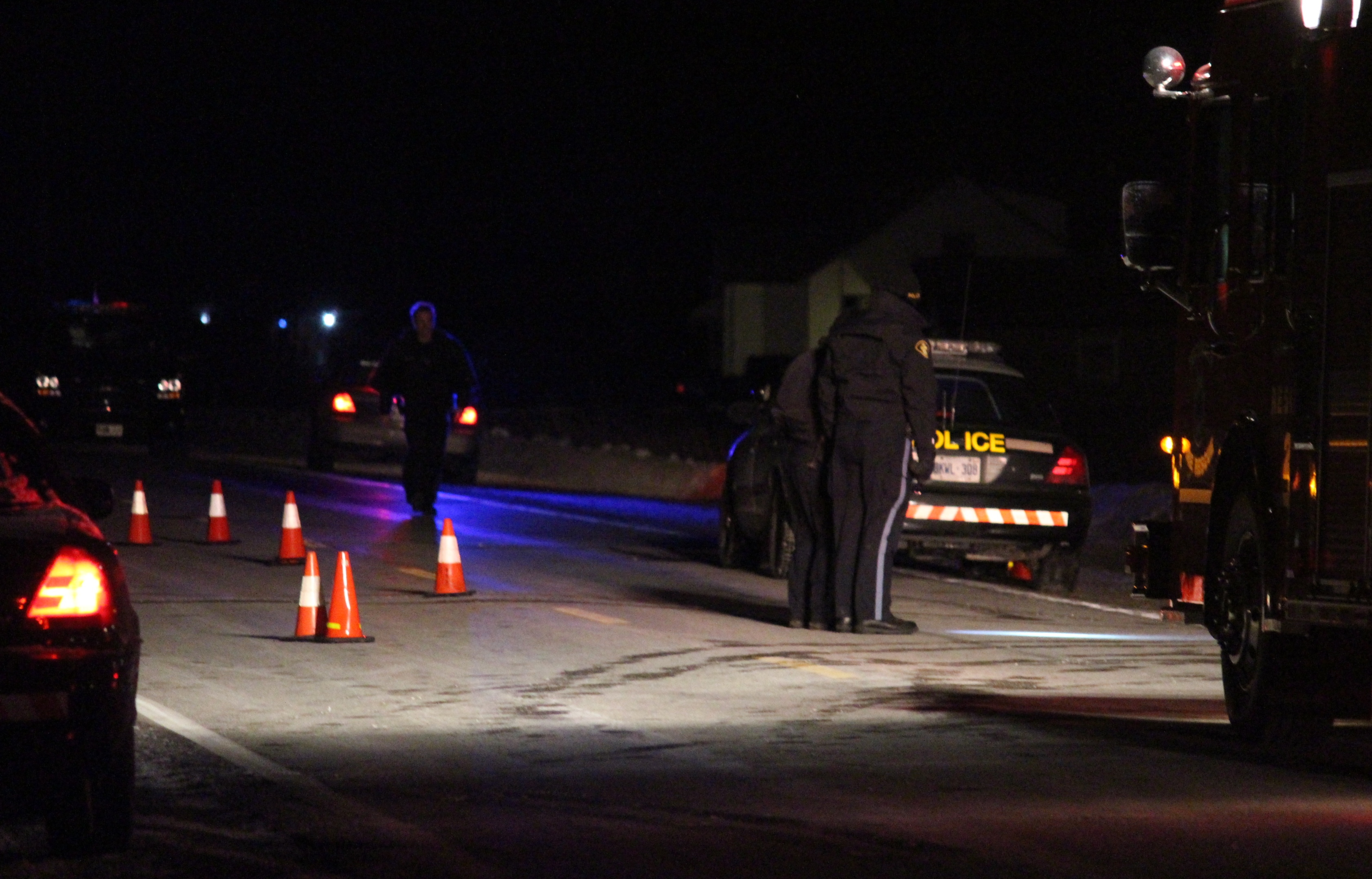 OPP officers investigate a fatal incident on Walker Rd. in Oldcastle, February 9, 2015. (Photo by Mike Vlasveld)