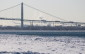 BlackburnNews.com file photo of the Ambassador Bridge along the Detroit River. (Photo by Jason Viau)