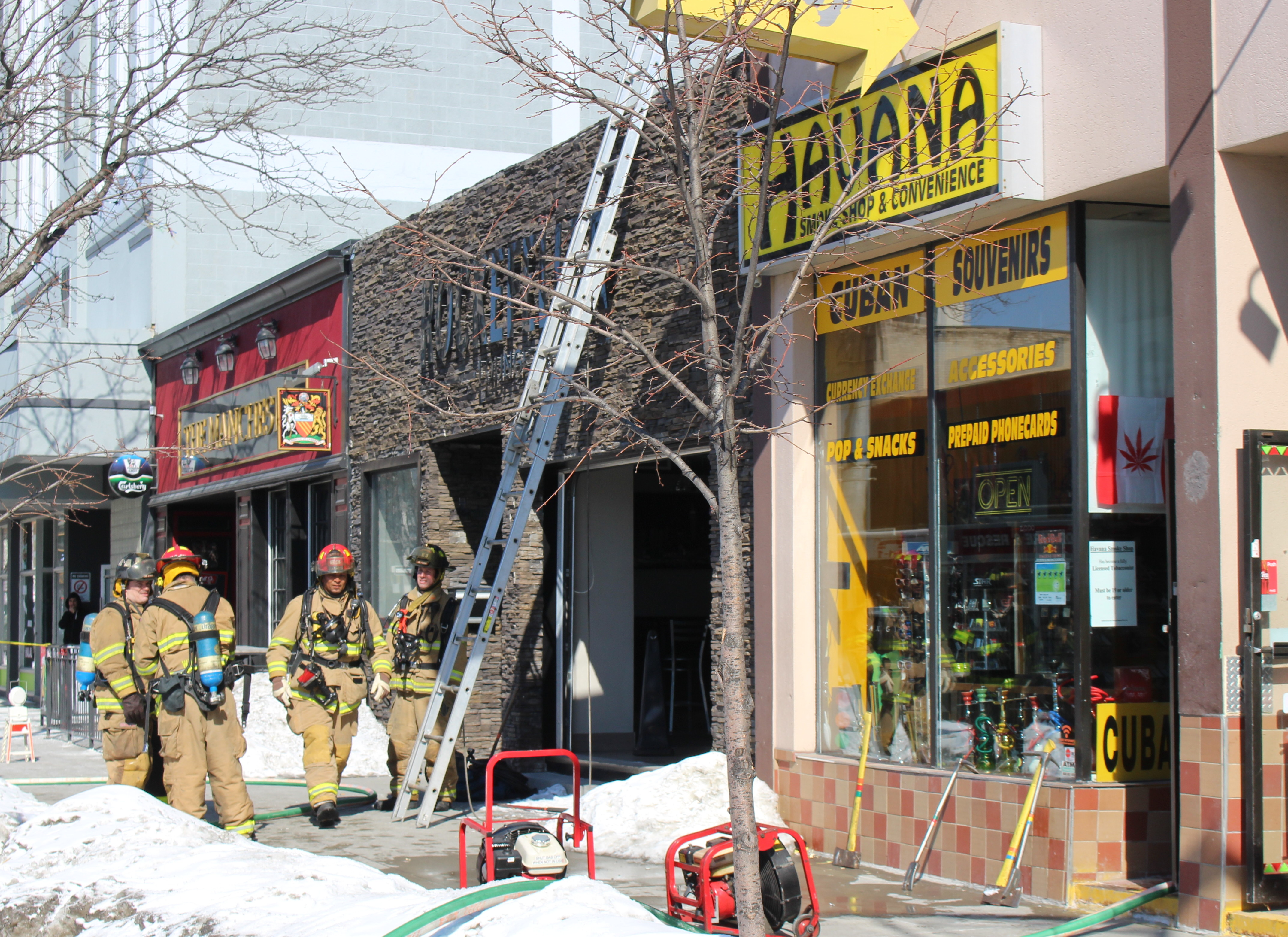Windsor firefighters respond to a blaze at Havana Smoke Shop & Convenience in the 500-block of Ouellette Ave. downtown, February 23, 2015. (Photo by Mike Vlasveld)