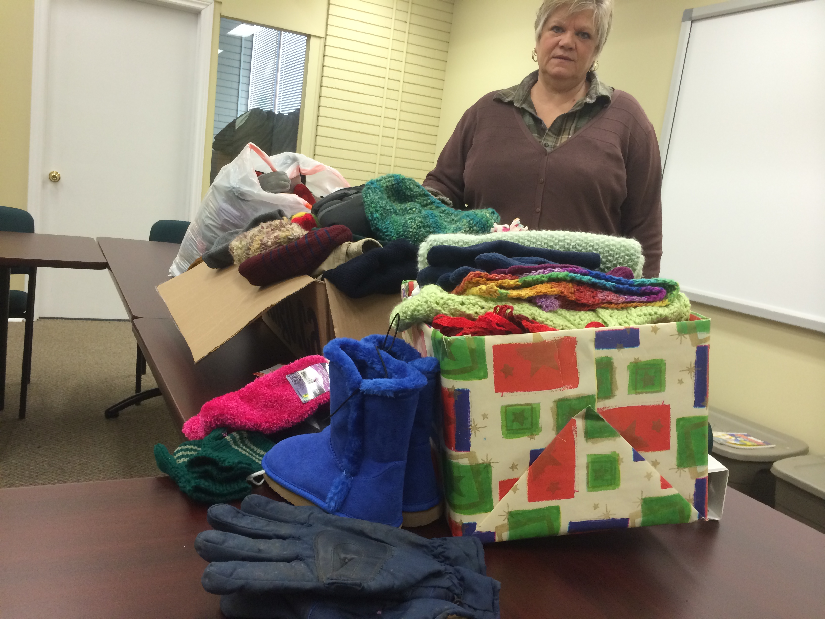 Chatham-Kent Salvation Army Family Services Coordinator Rhonda Dickson stands by donated mittens, scarves and toques at their offices at 19 Raleigh St. in Chatham on February 12, 2015. (Photo by Ricardo Veneza)