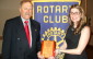 Amy Teed-Acres holds a specially made plaque presented to her by Rotarian Bernard Brunner. Brunner is the chair of the Meaford Rotary Club committee that chose her at Citizen of the Year for 2014. Photo by Jim Armstrong