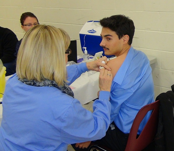Blackburnnews.com Reporter Jake Kislinsky gets his flu shot at one of the Chatham-Kent Public Health's clinics.