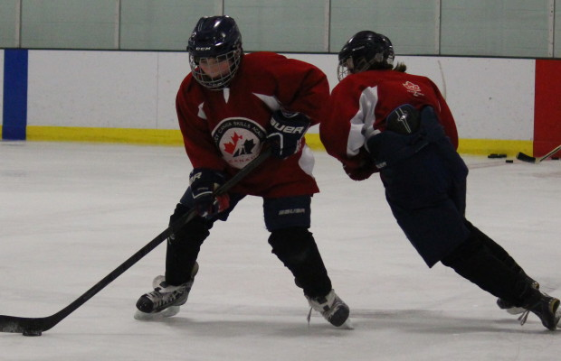 Students at the FJ Brennan Centre of Excellence & Innovation Hockey Canada Skills Academy take part in practice, March 5, 2015. (Photo by Mike Vlasveld)