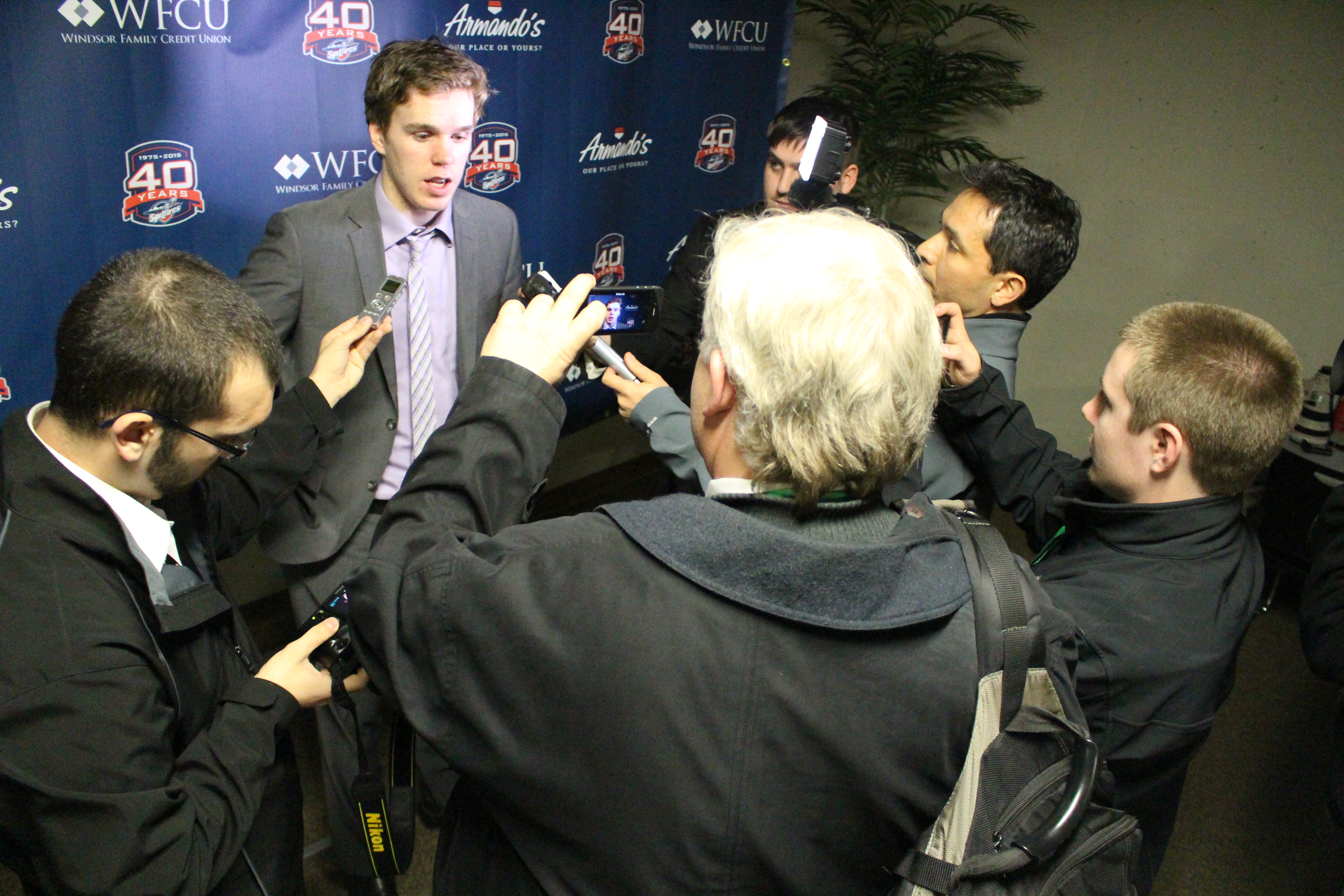 Erie Otter center Connor McDavid speaks with the media after beating the Windsor Spitfires on March 19, 2015. (Photo by Jason Viau)