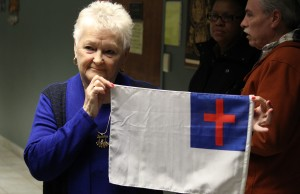 Cutting Edge International Church Pastor Shirley Walsh with the flag she wishes could fly at Windsor City Hall this summer, March 2, 2015. (Photo by Mike Vlasveld)