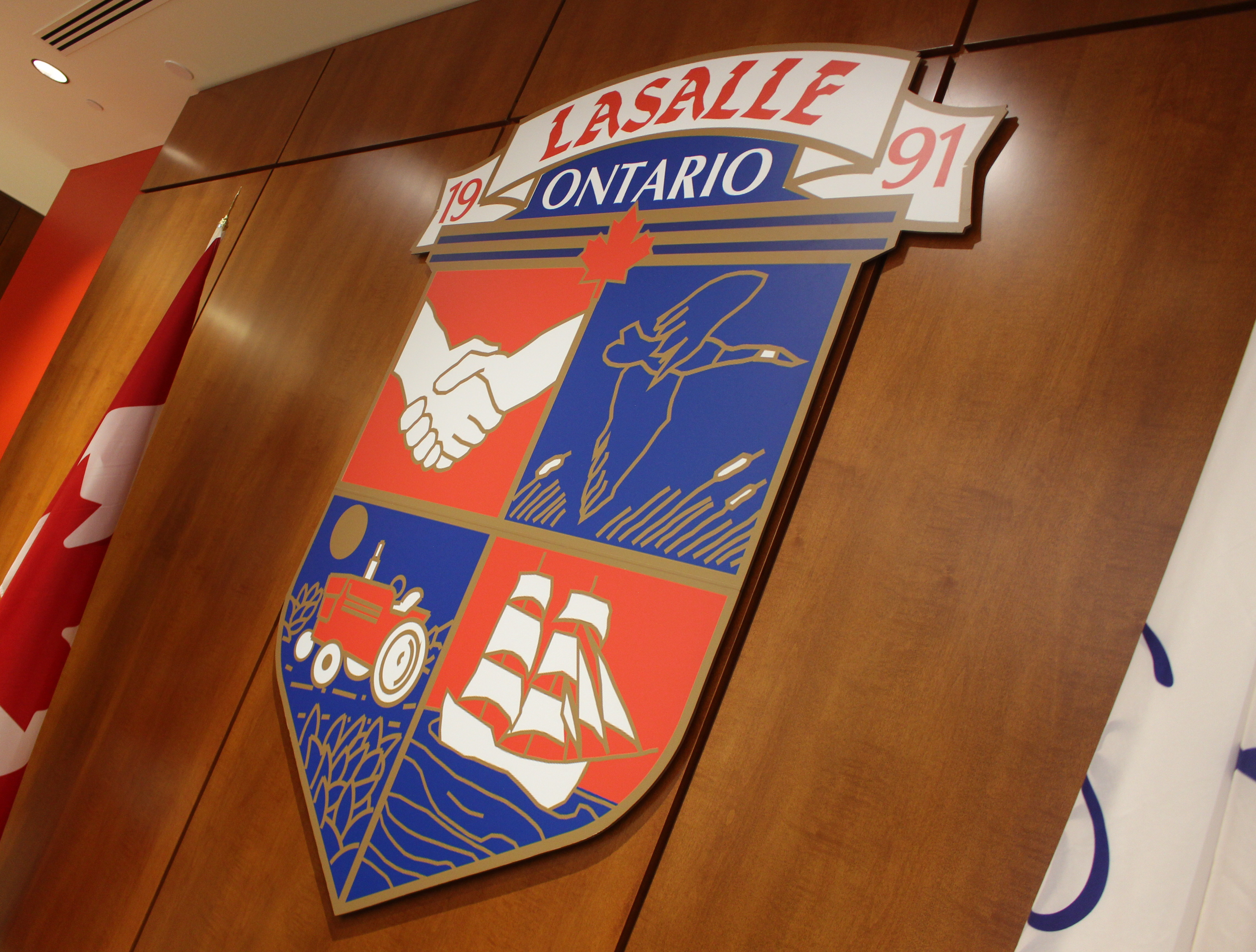 The Town of LaSalle's coat of arms hanging at LaSalle Town Hall. (Photo by Mike Vlasveld)