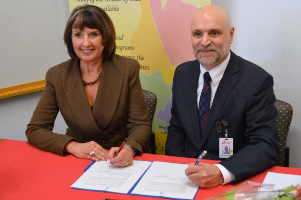 Gwen Devereaux, President of Gateway Centre of Excellence in Rural Health [L] and Paul Rosebush, President and CEO of South Bruce Grey Health Centre sign a collaboration agreement between the two organizations. (Photo by Jordan MacKinnon)