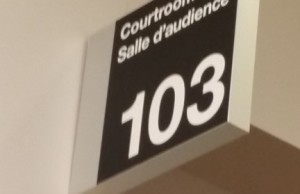 The sign outside courtroom 103 at the Chatham-Kent Courthouse (Photo by Jake Kislinsky)
