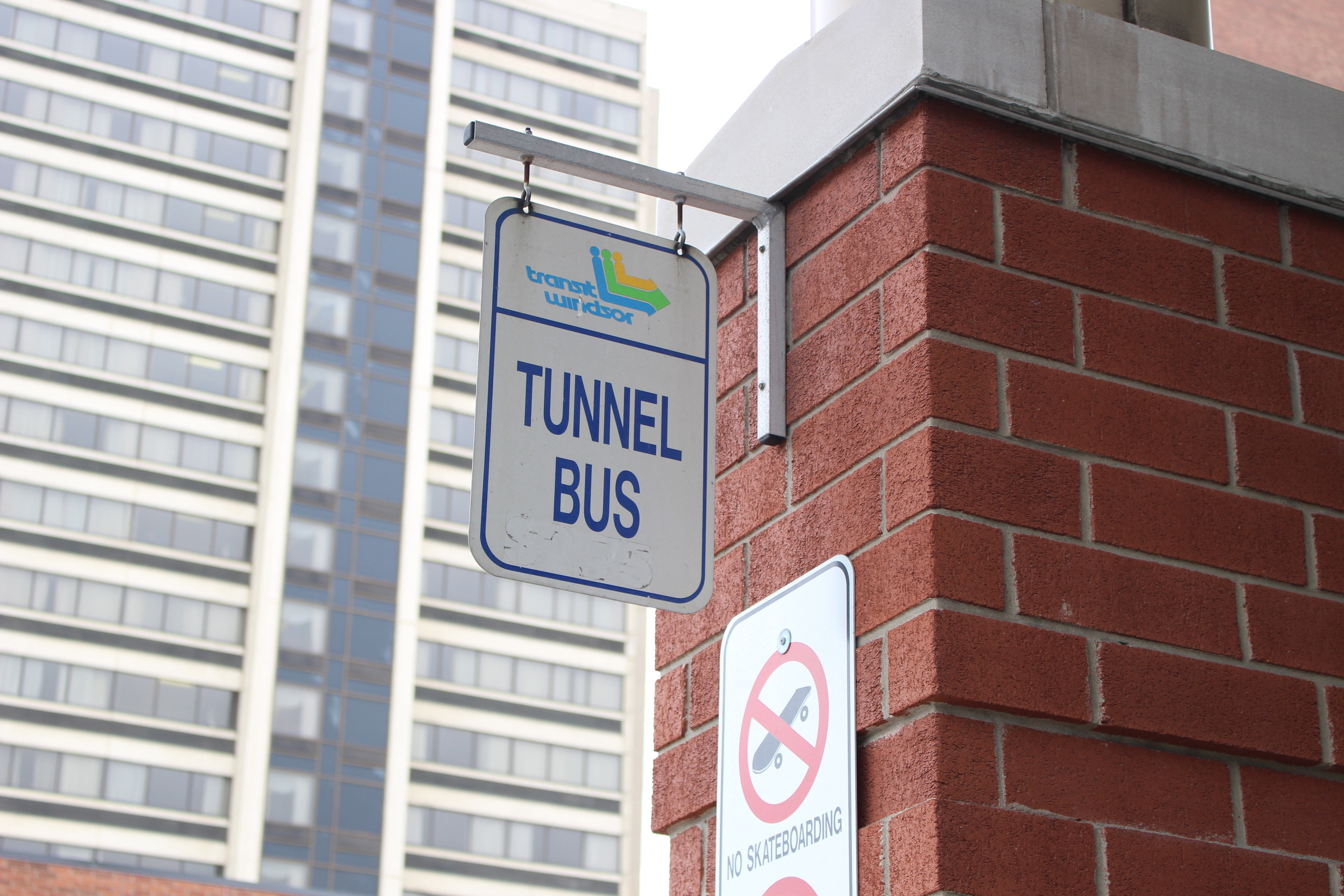 The Tunnel Bus sign hangs out front of the Transit Windsor bus terminal downtown on April 6, 2015. (Photo by Ricardo Veneza)