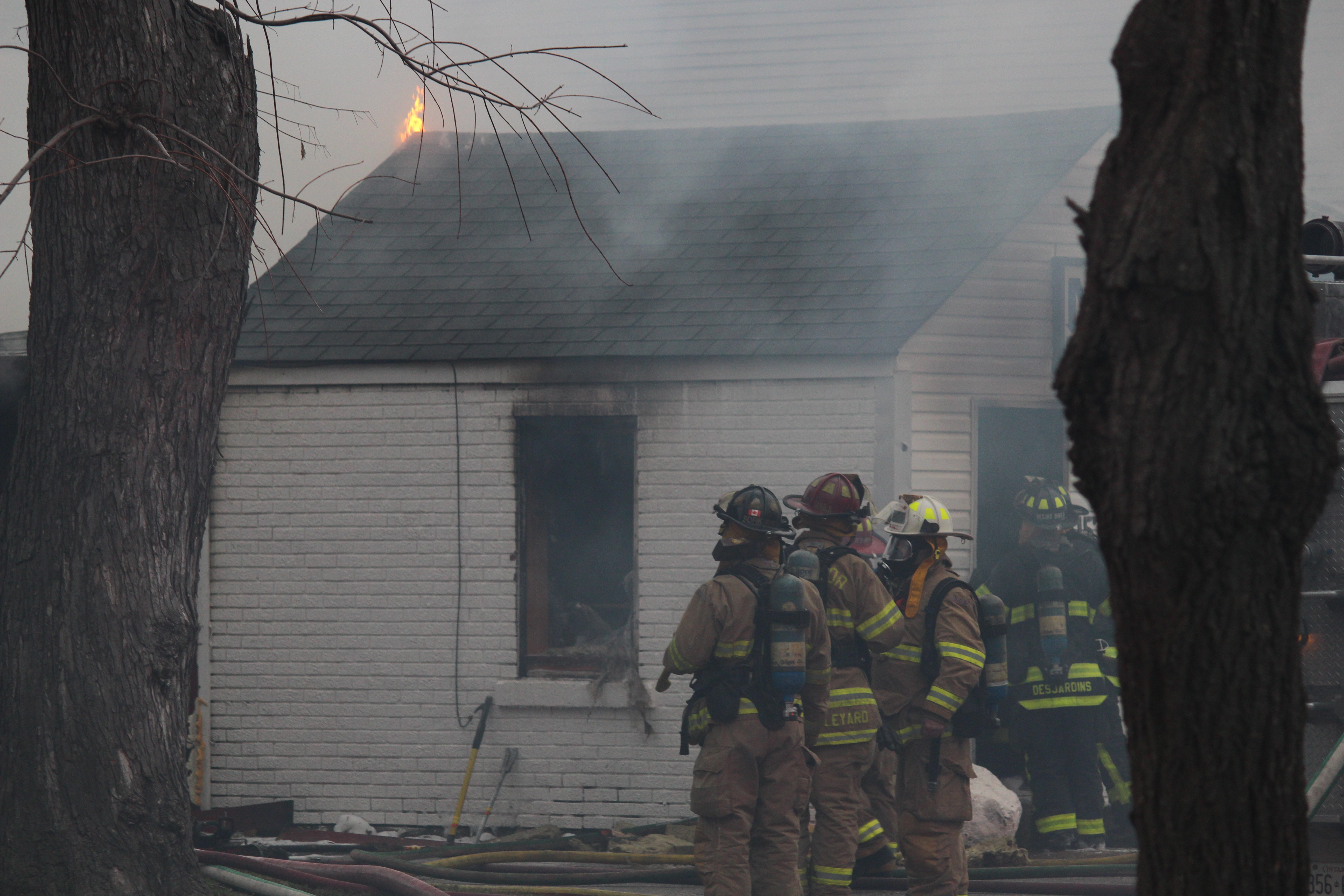 Windsor fire crews battle a blaze at 1574 Gladestone Ave., April 7, 2015. (Photo by Jason Viau)