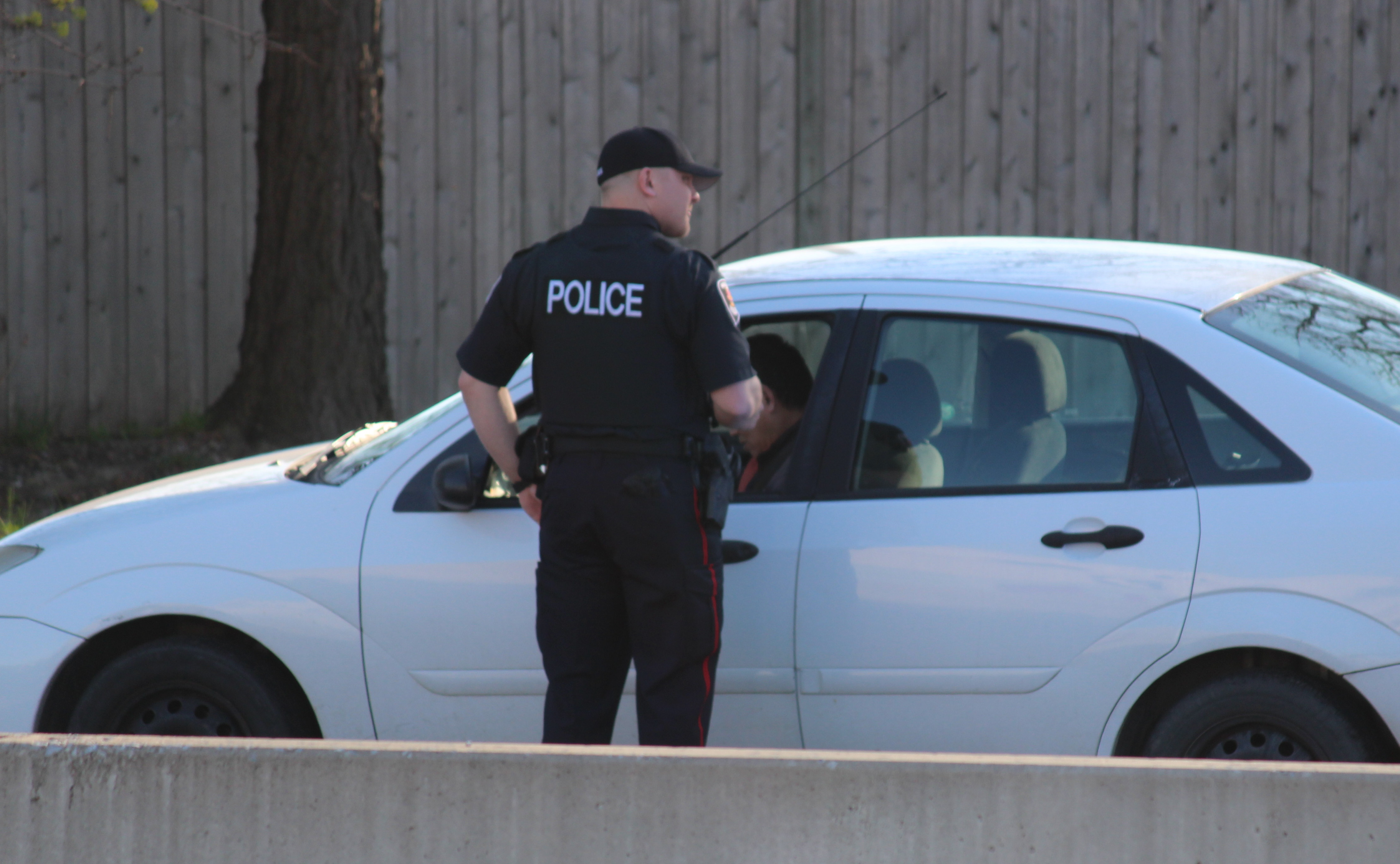 A Windsor police officer performs a traffic stop on Huron Church Rd., April 28, 2015. (Photo by Jason Viau)