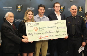 Money raised through St. Clair College's Polar Plunge to be donated to the Special Olympics of Ontario, April 23, 2015. (Photo by Mike Vlasveld)