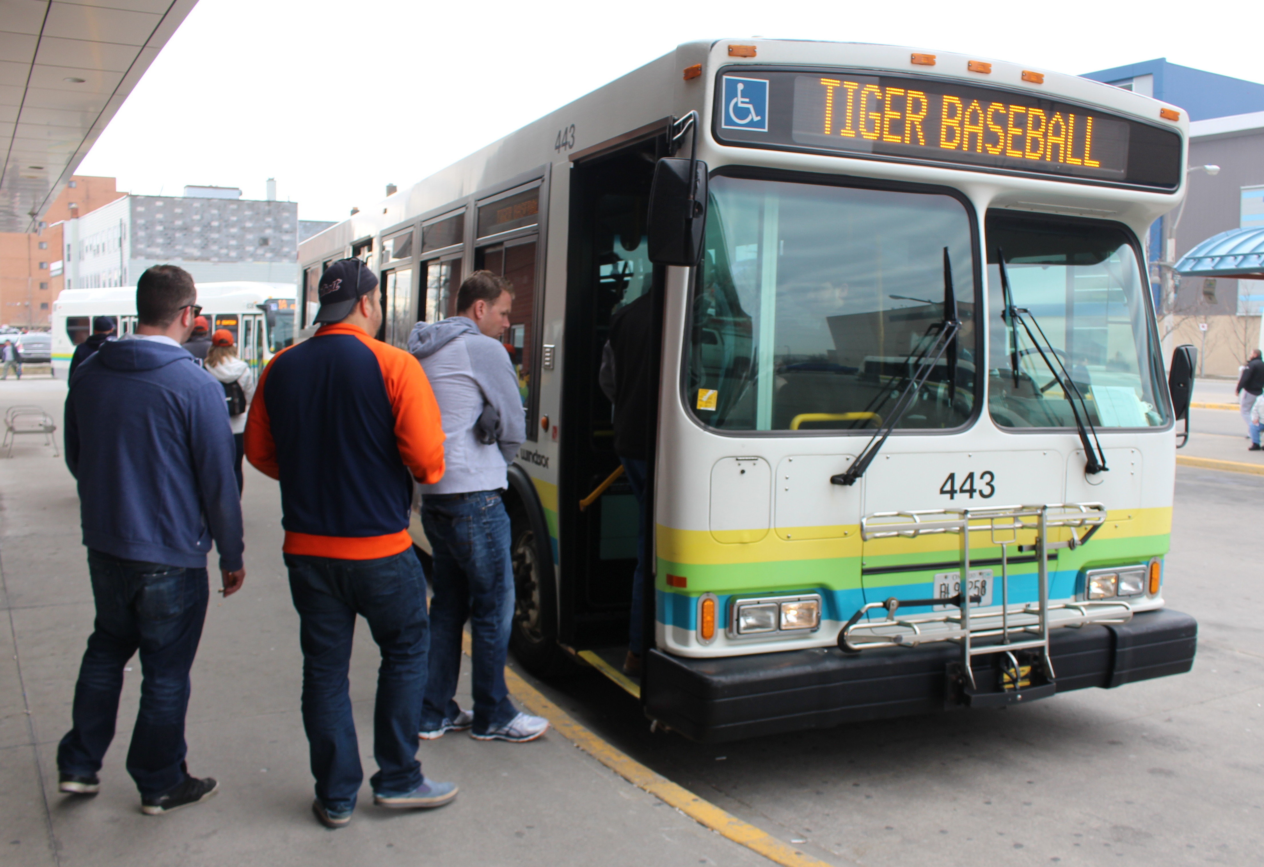Detroit Tigers baseball fans board the Transit Windsor Tunnel Bus on Opening Day 2015, April 6, 2015. (Photo by Mike Vlasveld)