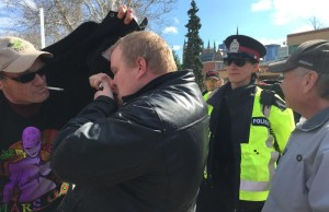 A man is arrested for smoking marijuana in London's Victoria Park during a 4/20 demonstration. Photo by Ashton Patis.