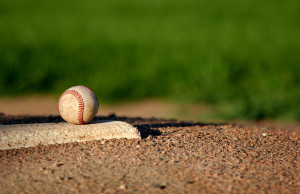 Baseball on a pitcher's mound. Photo courtesy of © Can Stock Photo Inc./alptraum