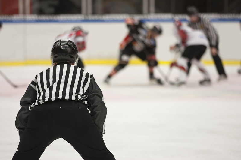 Ice hockey refree. Photo courtesy of © Can Stock Photo Inc. / Modestil